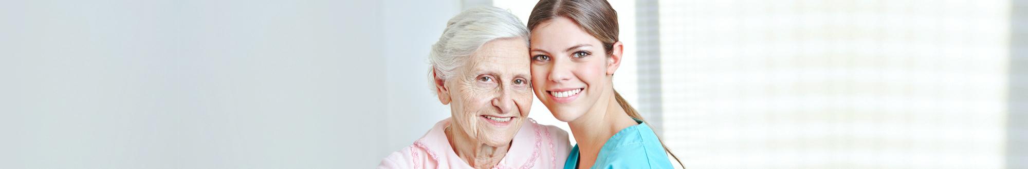 caregiver and senior woman smiling indoor